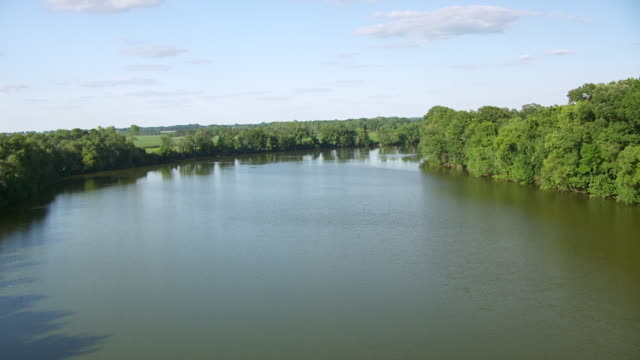 WS AERIAL POV Wabash River passing through farmland and forest area / Knox County, Vincennes, Indiana, United States