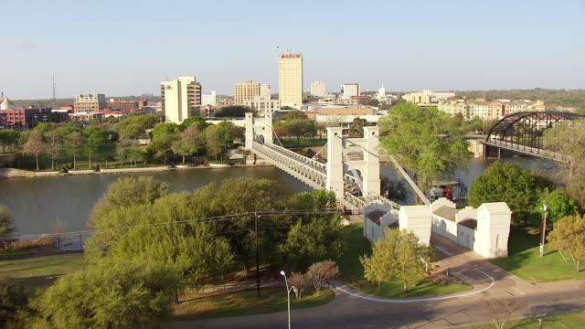 WS AERIAL Waco Suspension Bridge and approach ALICO building / Waco, Texas, United States