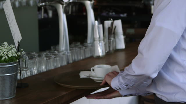 Waiter carrying tray