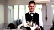 Waiter showing a tea tray