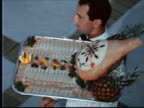 MONTAGE Waiters carrying large trays of gourmet food balanced on one hand / Hamilton, Bermuda