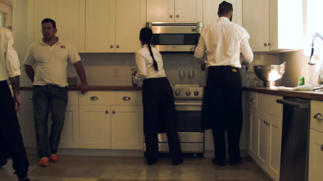 Waiters prepping food in the kitchen of the former home of Al Capone