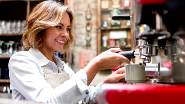 Waitress making a cup of coffee