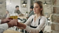 Waitress picking up a beer