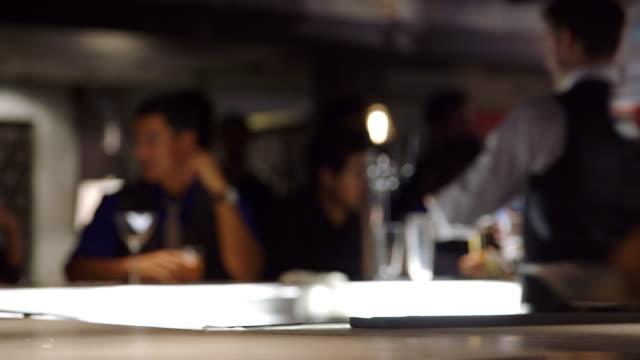 MS waitress placing drinks on bartop