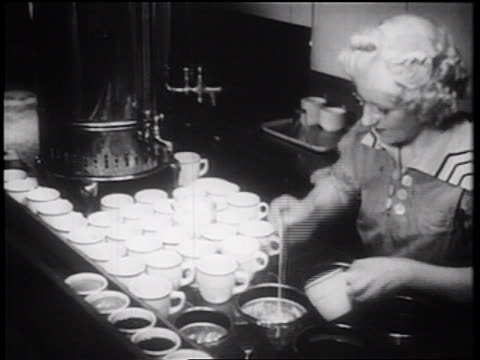 B/W 1939 waitress pouring coffee hurriedly in restaurant / NYC / documentary