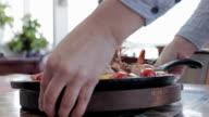 Waitress serving seafood
