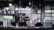 MS Waitress standing behind bar pouring cup of coffee into mug / Palmdale, CA, United States