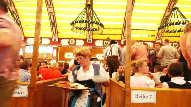 T/L Waitresses Serving Food In Oktoberfest Beer Tent