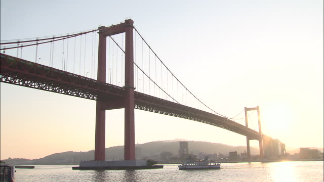 Wakato Ferry is passing through under Wakato Bridge, Japan