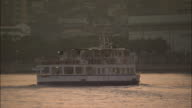 Wakato Ferry is sailing from the foreground to the back and turning to the right, Japan