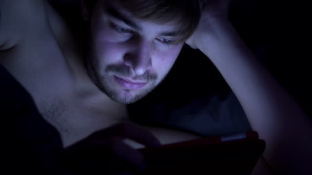 Waking to use a digital tablet.