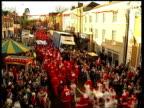 U WALES Newtown Mass of Santas running thru main street to raise money for charity CMS 'Elvis' Santa CMS Baby Santa MS Welsh Santas CMS Welsh woman...