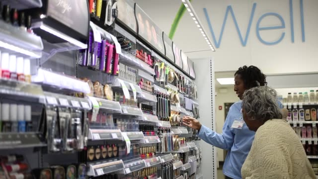 Walgreens employees stock shelves and help customers in the aisles at the register and at the pharmacy Cosmetics sandwiches workers price tag...