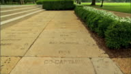 Walk w/ captain names hand football cleat foot impressions TD Walkway passing Ray Perkins 1966 to MS CoCaptain Joe Namath 1965 Iconic football player...