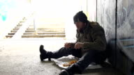 HD: Walking By A Homeless Person Eating Food