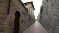 POV WS Walking down Narrow Alley Between Buildings / Tuscany, Italy