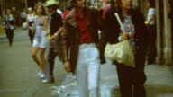 Walking down street / Signage for Toulouse and Royal / Posing in front of Monteleone / Orleans Tourists on May 01 1973 in New Orleans Lousiana