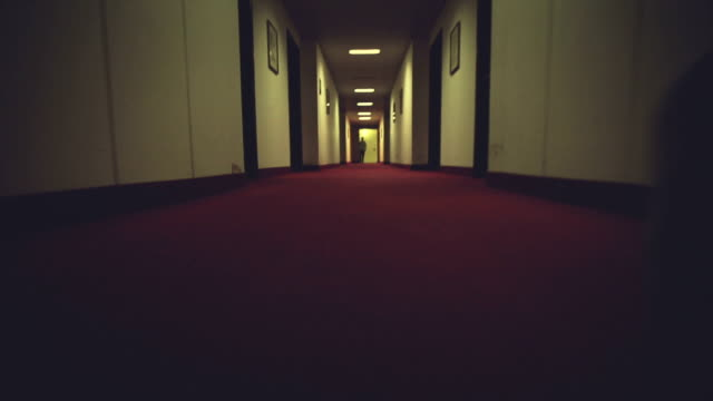Walking in a creepy hotel corridor