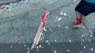 Walking in the Chinatown district of Los Angeles with lots of confetti on the ground for New Years celebrations