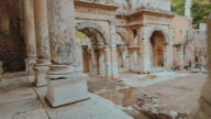Walking pan by ancient marble columns