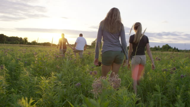 Walking with Family at Sunset