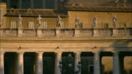 A walkway tops the colonnade of St. Peter's Square in Vatican City.