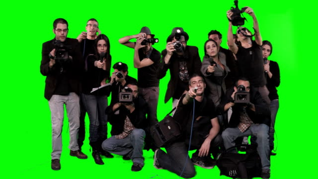 wall of photographers - green screen