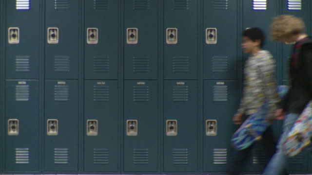 MS Wall of school lockers with children (12-17) walking in both directions, Cazenovia, New York, USA