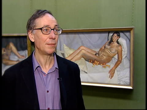 INT Gallery workers hanging paintings in exhibition of new Lucien Freud work Lucien Freud painting of his grandson Freud painting of dog William...