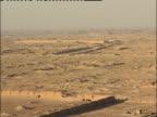 Walls create a boundary for a dig site near Samarra, Iraq.