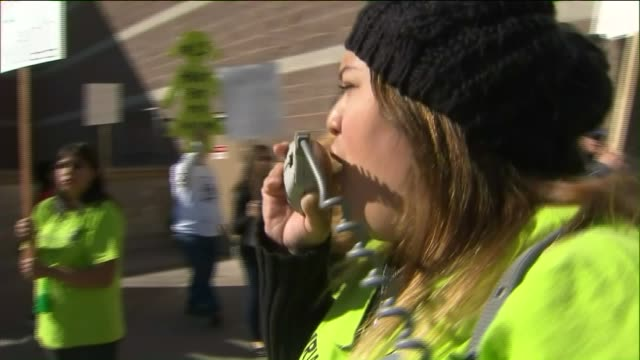 KTLA Walmart employees took the streets in a protest on Black Friday November 27 2015