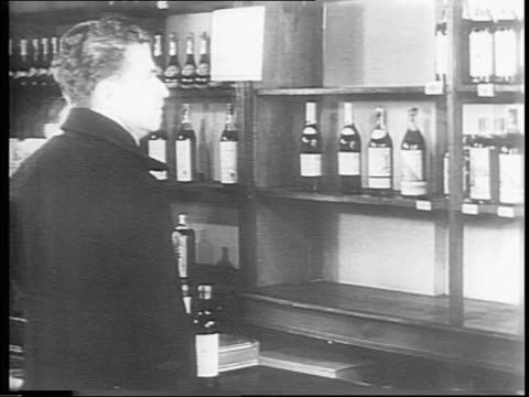 War causes shortage of alcohol / newspaper headlines 'Whisky in Stocking For ChristmasMebbeAnd Not a Drop to Drink' 'Reveal Liquor Black Market' and...
