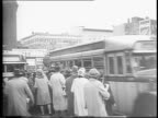 War Film Bulletin Number 6 / traveling during the holiday season may delay the homecoming of servicemen / crowd of people waiting in line for buses...
