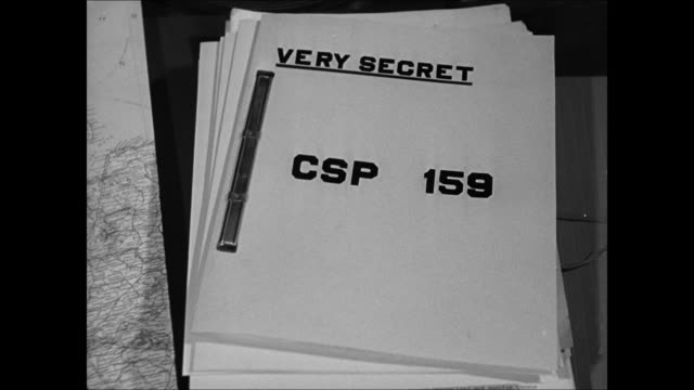 WS War Office building London INT WS English Norwegian officials talking at desk CU Report 'Very Secret CSP 159' DRAMATIZATION MS Norwegian official...
