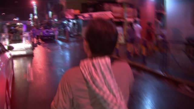 Death squad killings PHILIPPINES Manila EXT POV behind photographer Luis Liwanag as makes his way along to scene of latest killing Bare legs of...