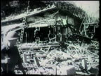 War torn damaged town of Lae Allied soldiers checking destroyed buildings various downed Japanese fighter planes amp aircrafts on field WWII World...