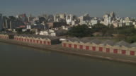 Warehouses, piers and container ships line the coast of Porto Alegre, Brazil.