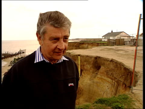 Warning of rising sea levels ITN Norfolk Happisburgh EXT Malcolm Kirby walking along cliff talking with Davies SOT I wouldn't put money on this being...