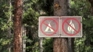 MS Warning signs on tree / Banff National park, Alberta Canada