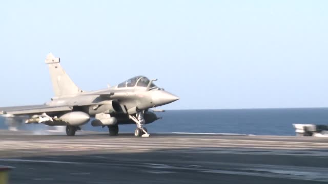 Warplanes take off from Frances Charles de Gaulle aircraft carrier newly deployed to the eastern Mediterranean for operations over areas held by the...