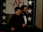 Warren Beatty and Annette Bening talk together on the red carpet
