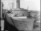 Warship SS Normandie on its side / stopmotion time lapse footage of raising the Normandie upright / ship in harbor renamed the USS Lafayette /...