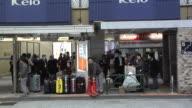 Wary travellers waiting for the Airport Bus at Shinjuku Terminal