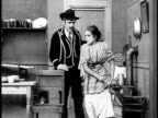 1910 B&W Washer woman giving stolen money to gambling salesman in kitchen/ USA
