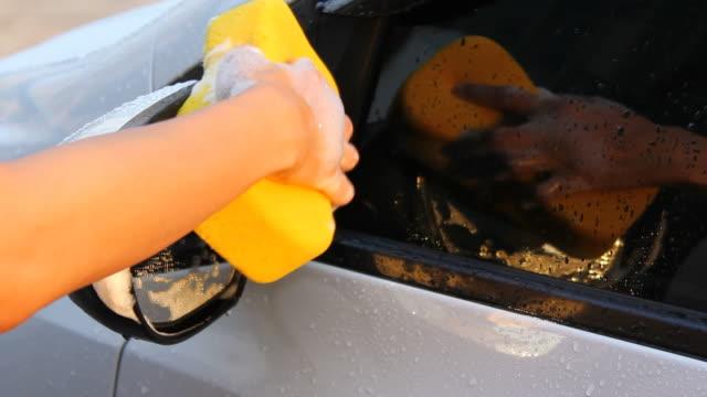 Washing a car mirror