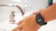 Washing hands under running water,Slow motion