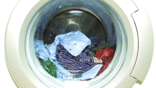 Washing machine with colorful laundry - zoom