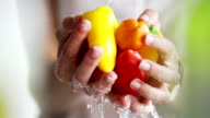 Washing peppers by hand