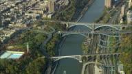 AERIAL WS Washington Bridge, Alexander Hamilton Bridge and High Bridge over Harlem River and Cross Bronx Expressway / New York City, New York, USA